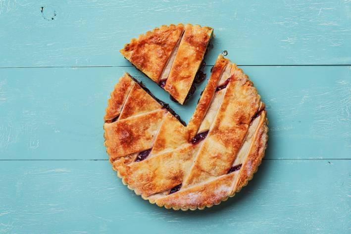 gluten-free cherry pie on blue wood background