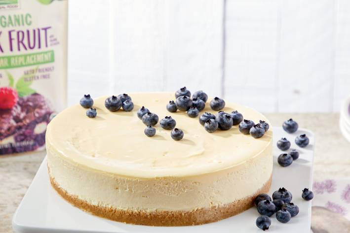 cheesecake on a graham crust with blueberries on top