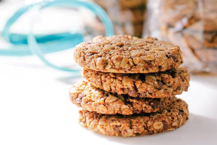 A stack of granola cookies with chocolate and nuts