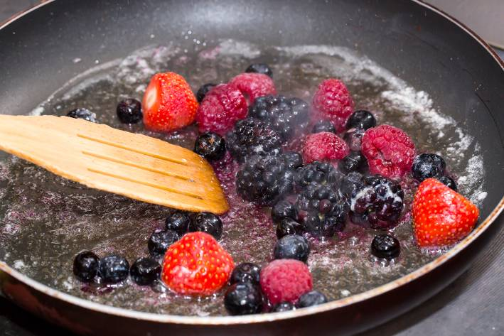 berries simmering in a pan to soften