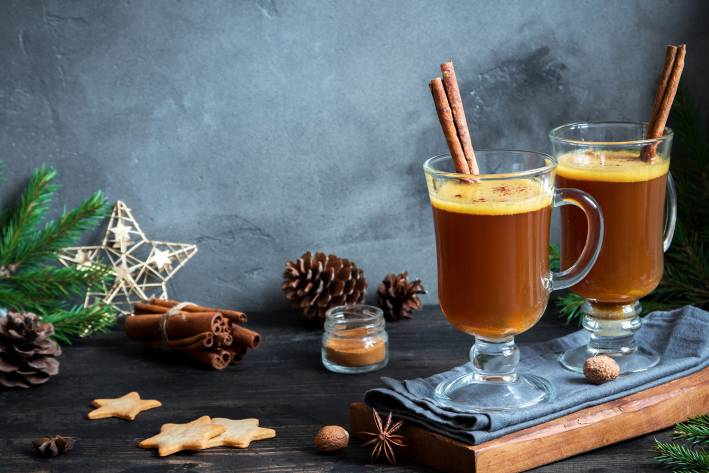 Hot buttered rum cocktail with cinnamon for winter holidays and colds.