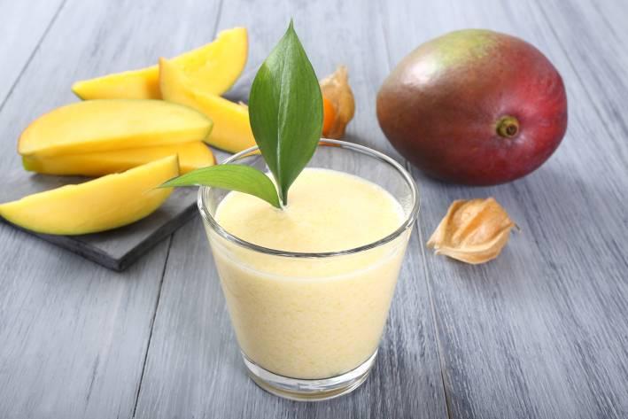 a glass of fresh mango smoothie