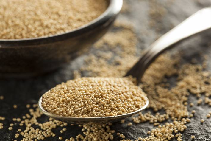 a spoonful of raw amaranth and a bowl of the ancient grain