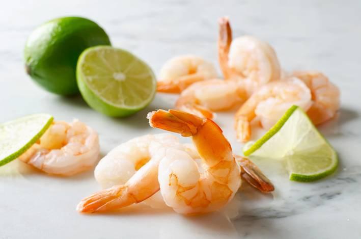 shrimp and sliced limes