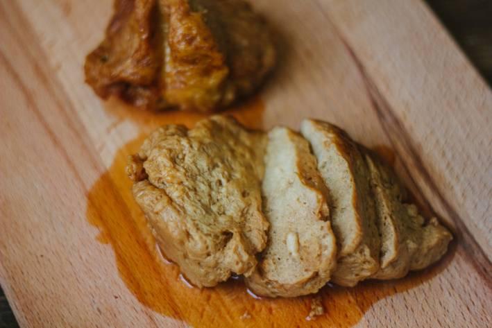 Sliced Seitan Roast on a cutting board.