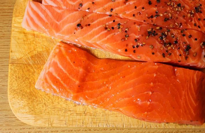 Salmon prepared for grilling.