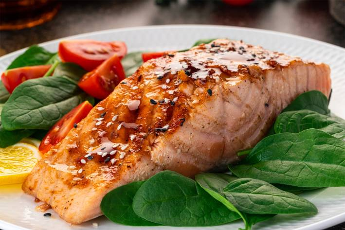 roasted salmon on a bed of greens