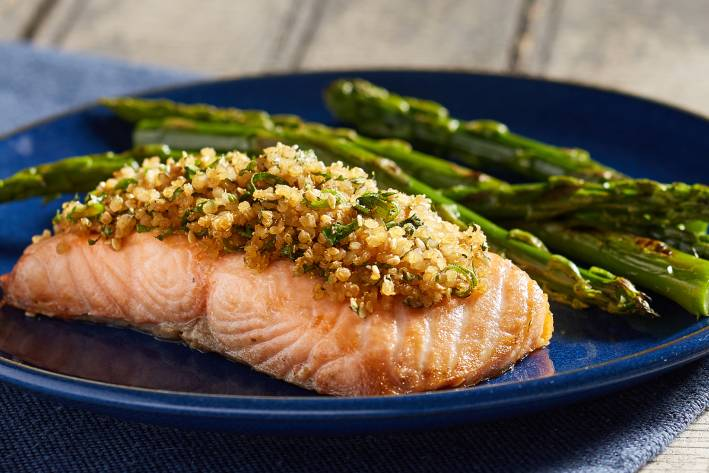 A plate of salmon crusted with quinoa