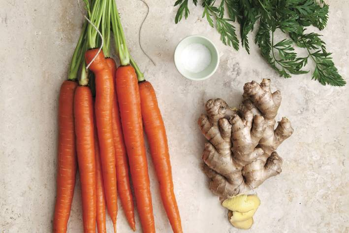 Carrots, ginger, and salt on a table