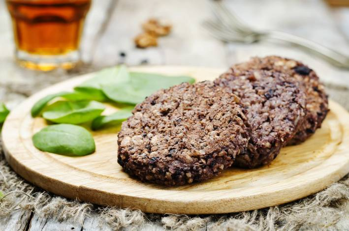 Prepared Chipotle Black Bean and Rice Burgers on a cutting board.
