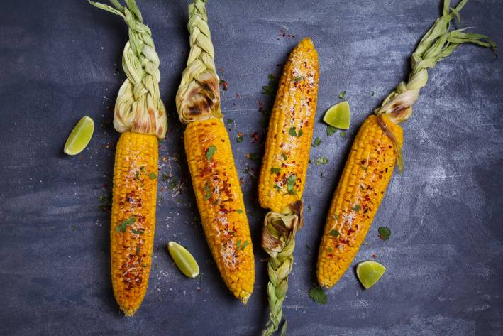 ears of grilled corn with lime, paprika, and cheese