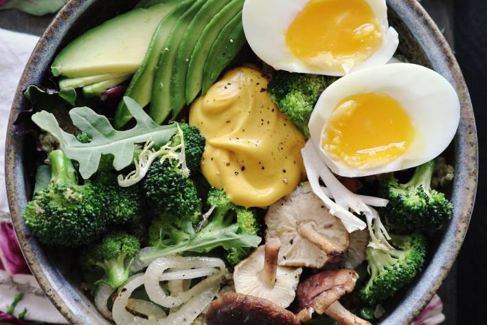 A nutritious power bowl with a dollop of homemade dressing