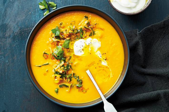 a garnished bowl of carrot soup
