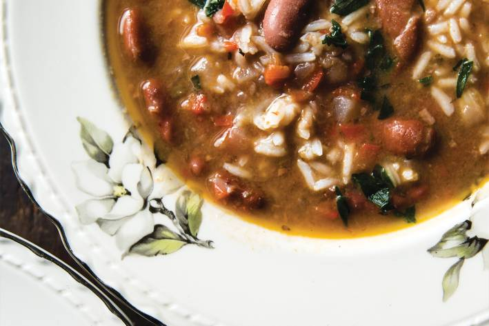 Red Beans and Rice Soup in a white bowl with floral accents.