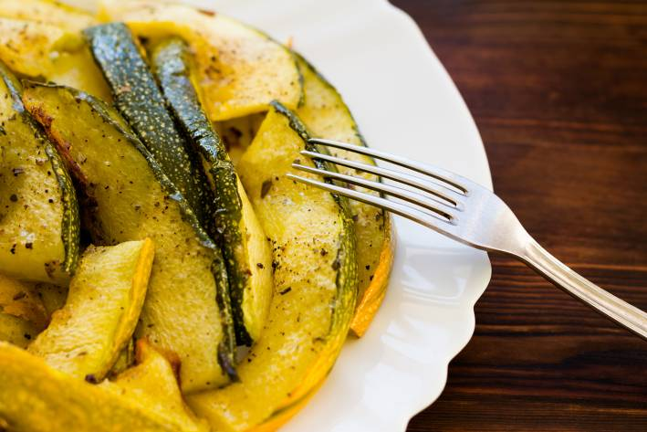 a hot plate of roasted zucchini