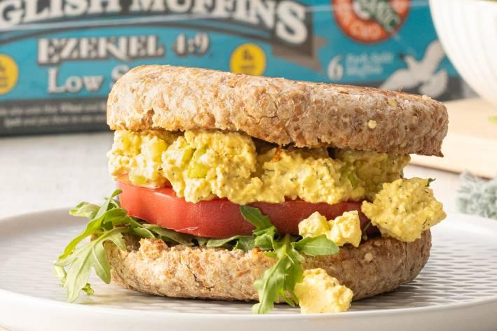 a stacked vegan breakfast sandwich