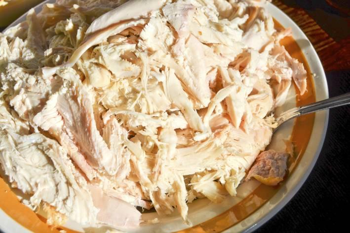 Leftover turkey meat, shredded on a dinner plate