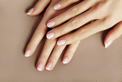 A woman's hands with well groomed healthy nails.