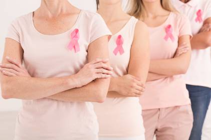 Women standing together against breast cancer