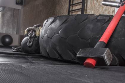 Different crossfit equipment used for crossfit training in a gym.