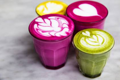 Beetroot, matcha,turmeric lattes are on the marble table.