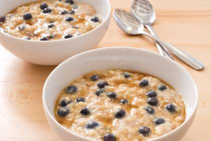Delicious healthy bowls of ancient grain oatmeal with blueberries