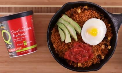 A pan of quinoa, egg, avocado, and salsa