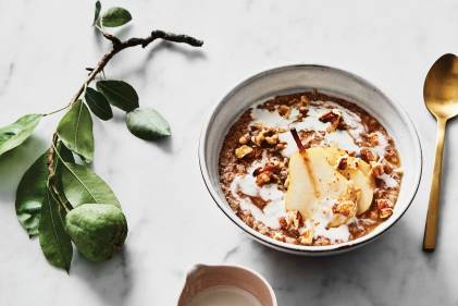 a bowl of pear porridge and a dish of honey
