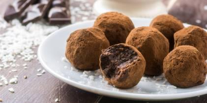 A plate of dark chocolate truffles