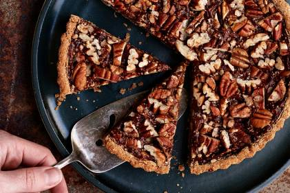 Pumpkin Pecan Tart being served.