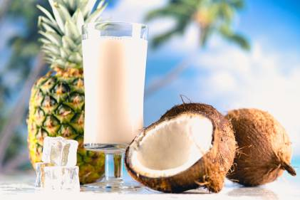 A cold glass of pineapple coconut smoothie