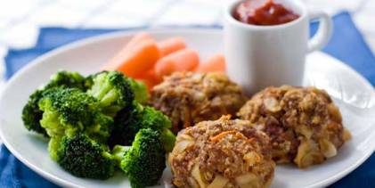 Mac and cheese meatballs with broccoli and carrots.