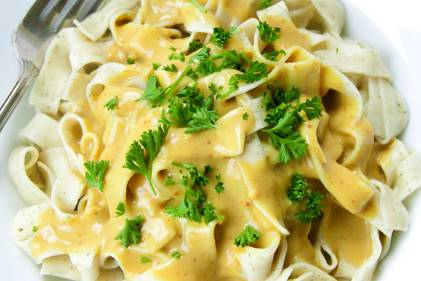 A plate of artichoke ribbon pasta with curry sauce