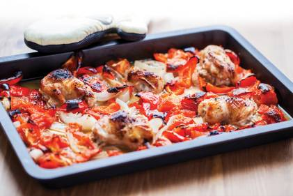 Ratatouille Sheet Pan Chicken just pulled out of the oven next to oven mitt.