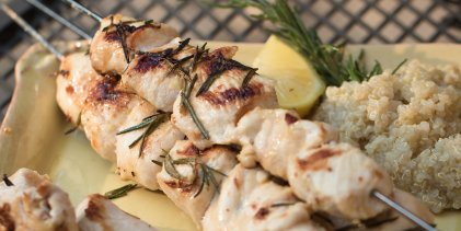 chicken skewers with rosemary on a grill