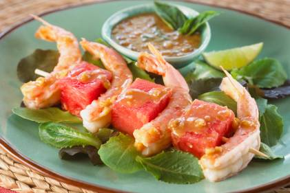 shrimp and cubes of watermelon plated nicely