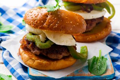A plate of chicken sausage sliders with bell peppers and fresh basil
