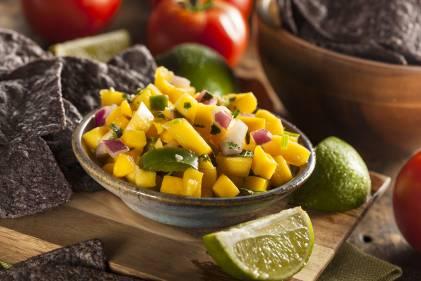 A bowl of mango chipotle salsa.