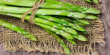 Bunch of green asparagus on burlap.