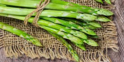 Bunch of green asparagus on burlap.