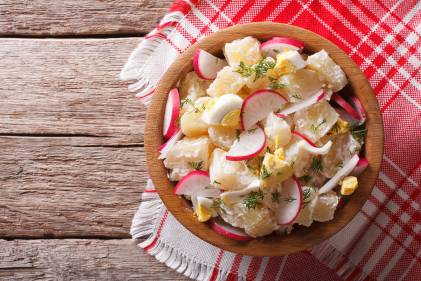 Fresh Spring Potato Salad in a wooden bowl ready to serve.