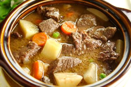 Rich hearty oven beef stew simmering and ready to serve.