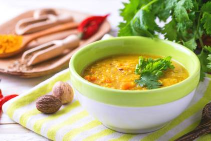A steaming bowl of red lentil Dal Masoor