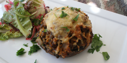 Baked stuffed mushrooms with cheese.