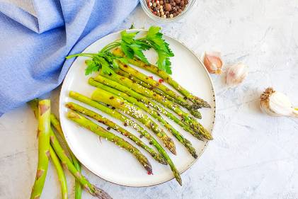 a plate of asparagus with garlic