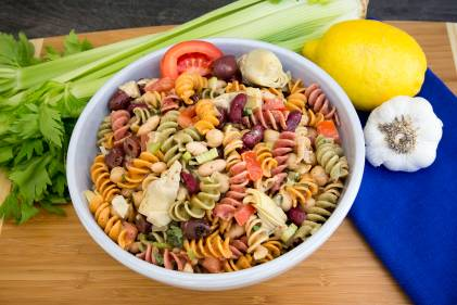 A bowl of three-bean pasta salad with vegetables
