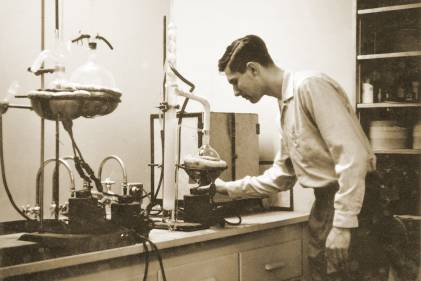 An old photo of Elwood Richard working in his lab