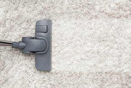 Vacuum on white shag carpet.