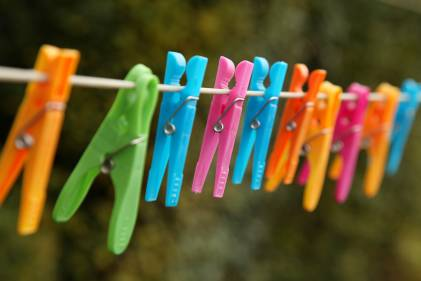 A clothesline with colorful pins