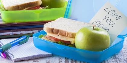 A healthy lunchbox with a note from mom